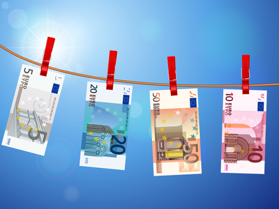 euro banknotes on clothesline