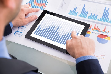 Businessman Analyzing Graph On Digital Tablet